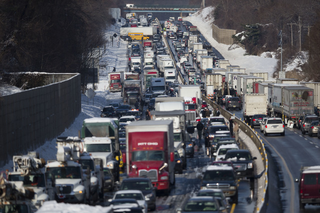 Vehicles are piled up in an accident Friday in Bensalem, Pa. Traffic accidents involving multiple tractor trailers and dozens of cars have completely blocked one side of the Pennsylvania Turnpike  ...