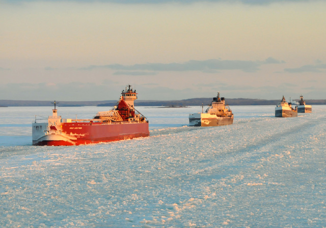 In this Jan. 9, 2014 photo provided by the U.S. Coast Guard a convoy of Great Lakes cargo ships line up to follow an icebreaker on the St. Marys River, which links Lakes Superior and Huron. As of  ...