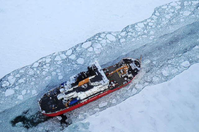 In this Dec. 26, 2013 photo provided by the U.S. Coast Guard the icebreaker Mackinaw maintains a shipping lane on the St. Marys River linking Lakes Superior and Huron. Its been so bitterly cold fo ...