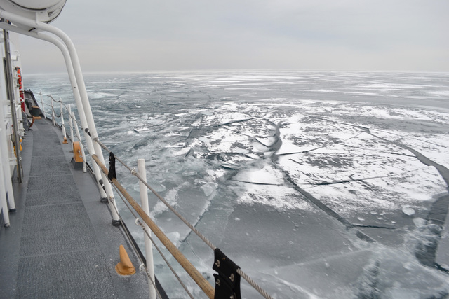 The Coast Guard Cutter Biscayne Bay, a 140-foot ice-breaking tug, sails the waters near Chicago and toward the shores off Indiana, Feb. 12, 2014. The Biscayne Bay helped break ice on the southern  ...