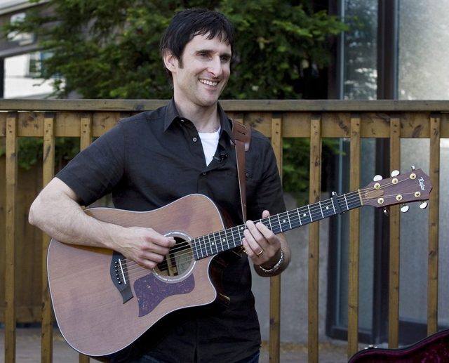 Musician Dave Carroll, of the pop-folk band Sons Of Maxwell, holds his repaired Taylor guitar in Halifax, Nova Scotia. Carroll became an Internet sensation after posting a revenge song about airli ...