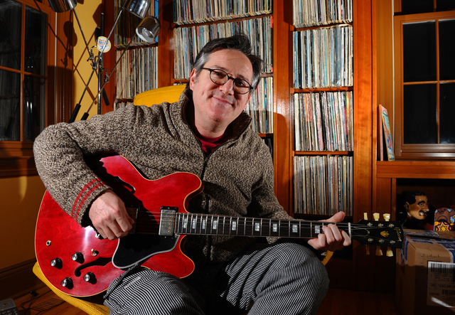 David Schneider poses with his new custom Gibson guitar at his home in Fairfield, Conn. It was given to him by Gibson after hearing of his plight of a broken Gibson guitar due to baggage handlers  ...