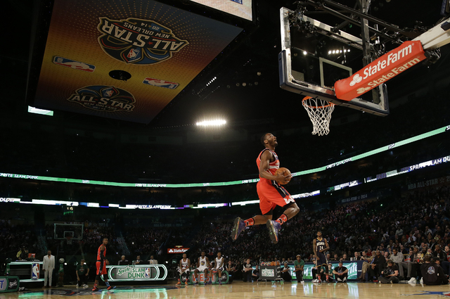 John Wall of the Washington Capitals participates in the slam dunk contest during the skills competition at the NBA All Star basketball game, Saturday, Feb. 15, 2014, in New Orleans. (AP Photo/Ger ...