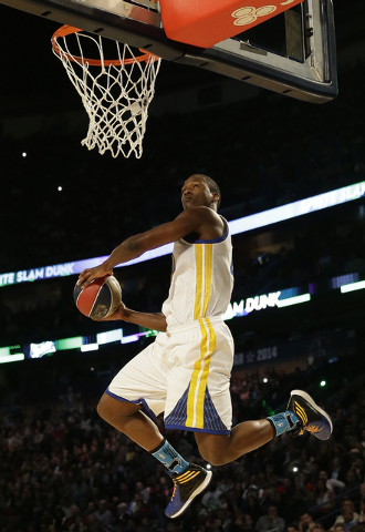 Paul George of the Indiana Pacers participates in the slam dunk contest during the skills competition at the NBA All Star basketball game, Saturday, Feb. 15, 2014, in New Orleans. (AP Photo/Gerald ...