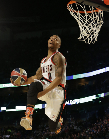 Damian Lillard of the Portland Train Blazers participates in the slam dunk contest during the skills competition at the NBA All Star basketball game, Saturday, Feb. 15, 2014, in New Orleans. (AP P ...