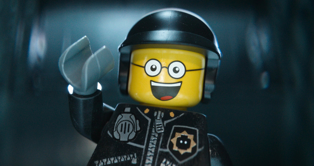 """This image released by Warner Bros. Pictures shows the character Bad Cop/Good Cop, voiced by Liam Neeson, in a scene from """"The Lego Movie."""" The Lego Movie is expected to take the top spo ..."""