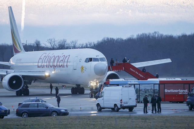 Passengers are evacuated from a hijacked Ethiopian Airlines Plane on the airport in Geneva on Monday. A hijacked aircraft traveling from Addis Abeda, Ethiopia, to Rome, Italy, landed at Geneva's i ...