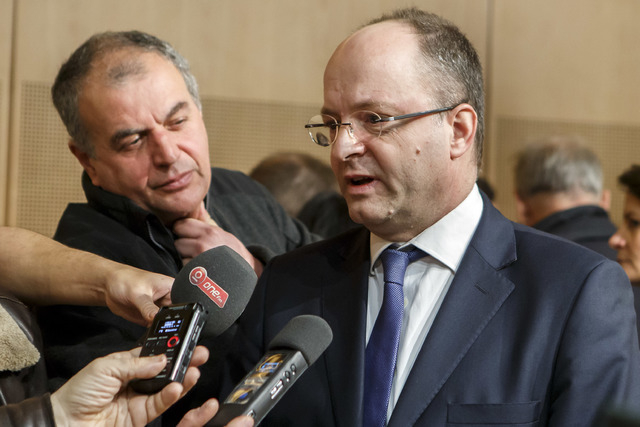 Olivier Jornot, prosecutor general of the Canton of Geneva, right, answers questions to reporters about a hijacked Ethiopian Airlines Plane during a press conference on Monday in Geneva. The Ethio ...