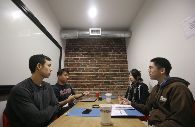 articipants Ian Wong, from left, Willy Chu, Yuriko Tamura and Steve Nguyen meet during a coding and team formation session at FinCapDev San Francisco Hackathon on Feb. 8 in San Francisco. (AP Phot ...