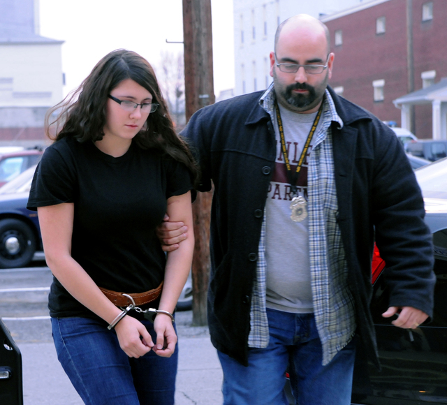 In this Tuesday, Dec. 3, 2013 file photo, Miranda K. Barbour is led into District Judge Ben Apfelbaum's office in Sunbury, Pa., by Sunbury policeman Travis Bremigen. In an interview with The Daily ...
