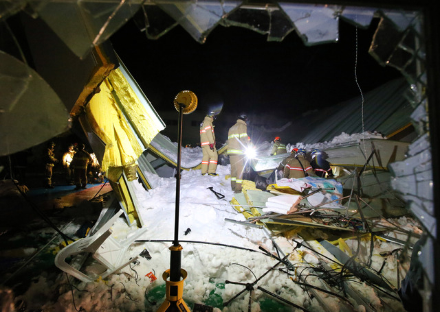 Rescue workers search for survivors from a collapsed resort building in Gyeongju, South Korea, on Monday. Four university students died and about 10 were feared trapped after the roof of a buildin ...