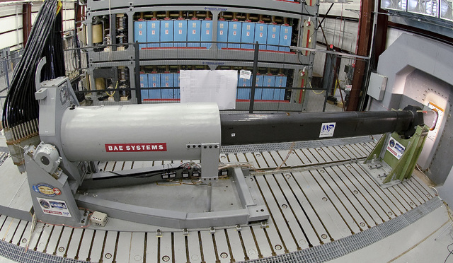Engineers prepare to test an electromagnetic railgun prototype launcher at a test facility in Dahlgren, Va., in 2012. The Navy plans to deploy its first laser on a ship in 2014, and intends to tes ...