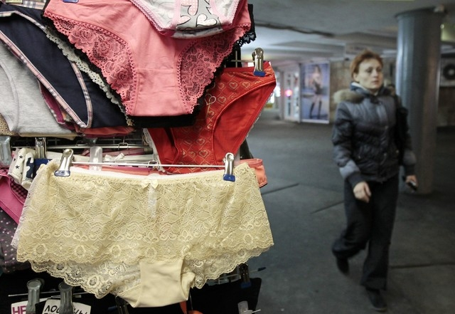 A woman passes a street side shop selling lace underwear in Kiev, Ukraine, on Monday. A trade ban on synthetic underwear has Russia and her economic allies with their knickers in a twist. (AP Phot ...