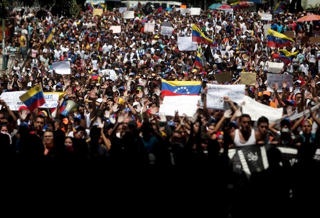 Students shout slogans against Venezuela's President Nicolas Maduro during a march to the Venezuelan Telecommunications Regulator Office or CONATEL in Caracas, Venezuela, Monday, Feb17, 2014. More ...