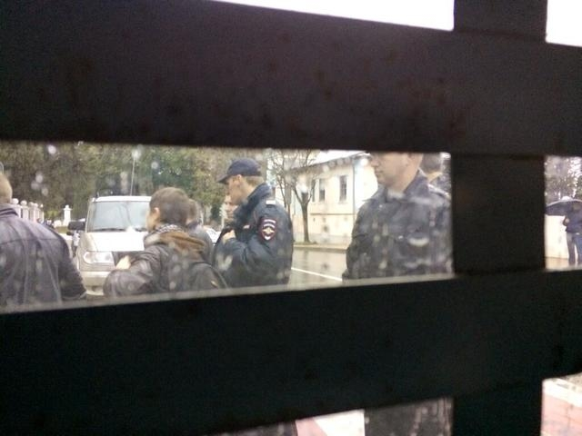 This photo provided by Maria Alekhina, a member of the punk band Pussy Riot, was taken from inside a police detention vehicle after she and several others were detained in Sochi, Russia, on Tuesda ...
