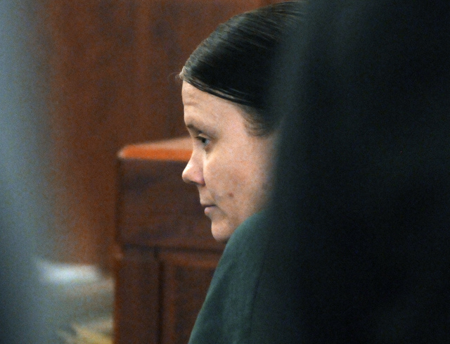Julie Corey sits in Worcester, Mass., Superior Court Tuesday, Feb. 18, 2014.  Corey was sentenced to life in prison for the 2009 murder of Darlene Haynes, her pregnant friend, three months after C ...