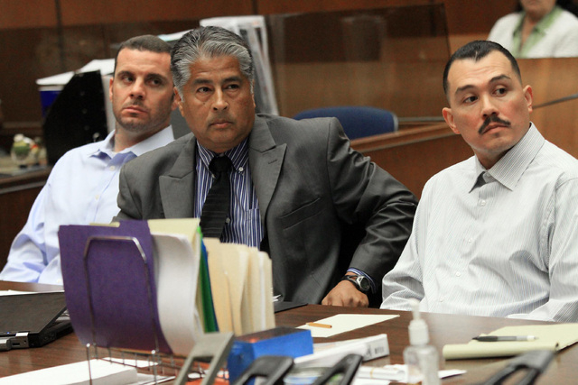 Marvin Norwood , left, with attorney Victor Escobedo, center, and co-defendant Louie Sanchez appear during a preliminary hearing held in Los Angeles Superior court on May 31, 2012. The two men hav ...