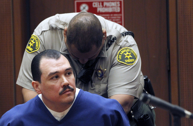 Defendant Louie Sanchez sits in court during a hearing Thursday Feb. 20, 2014 in Los Angeles. Sanchez and co-defendant, Marvin Norwood  pleaded guilty Thursday to a 2011 beating at Dodger Stadium  ...