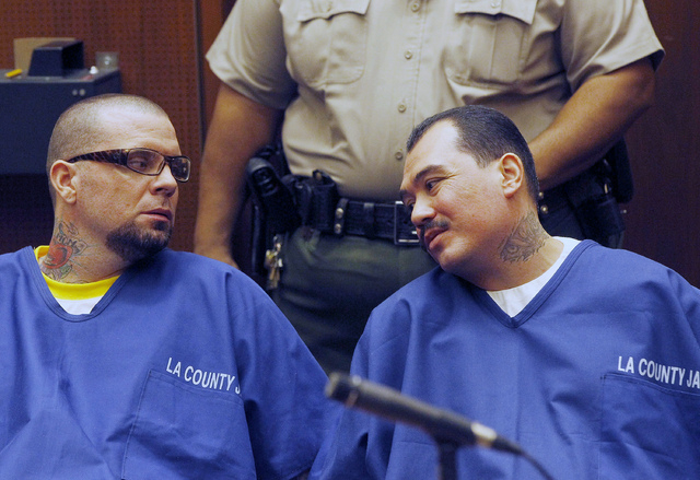 Defendants Marvin Norwood, left, and Louie Sanchez appear during a hearing Thursday Feb. 20, 2014 in Los Angeles. The two men pleaded guilty Thursday to a 2011 beating at Dodger Stadium that left  ...