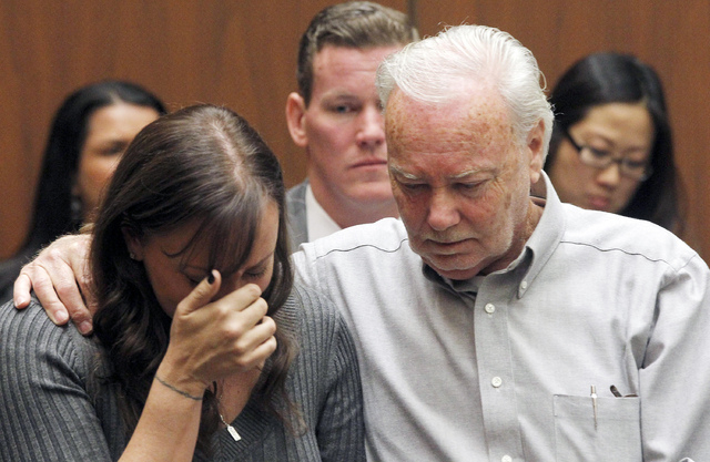 Evin Collins, and David Stow, sister and father of beating victim Bryan Stow are shown during a hearing Thursday Feb. 20, 2014 in Los Angeles. Two men, Marvin Norwood, and Louie Sanchez  pleaded g ...