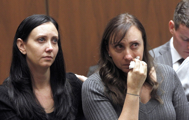 Evin Collins, and Bonnie Stow, sisters of beating victim Bryan Stow are shown during a hearing Thursday Feb. 20, 2014 in Los Angeles. Two men, Marvin Norwood, and Louie Sanchez  pleaded guilty Thu ...