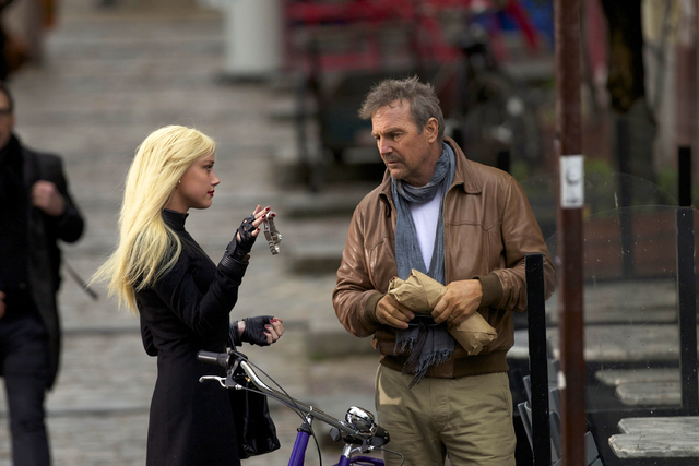 """This image released by Relativity Media shows Amber Heard, left, and Kevin Costner in a scene from """"3 Days to Kill."""" (AP Photo/Relativity Media, Julian Torres)"""