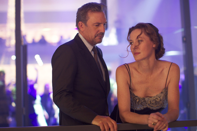 """This image released by Relativity Media shows Kevin Costner, left, and Connie Nielsen in a scene from """"3 Days to Kill."""" (AP Photo/Relativity Media, Julian Torres)"""