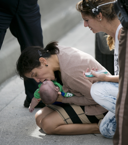 Pamela Rauseo, 37, performs CPR on her nephew, 5-month-old Sebastian de la Cruz, after pulling her SUV over on the side of the road along the westbound lane on Florida state road 836 just east of  ...