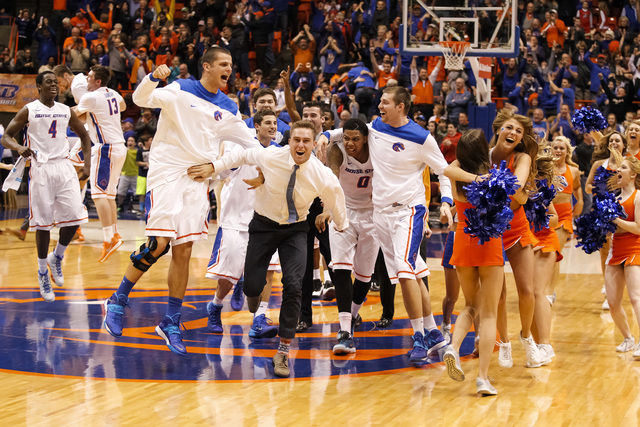 Boise State celebrates after a video review reveals they'd won an NCAA college basketball game against UNLV in Boise, Idaho, on Saturday, Feb. 22, 2014. Boise State won 91-90 in overtime. (AP Phot ...