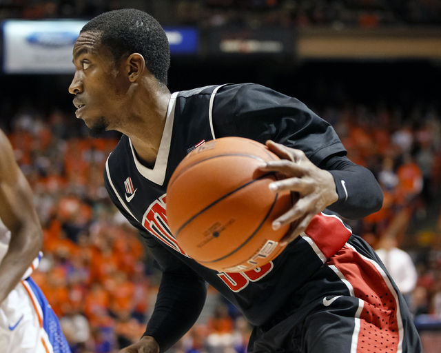 UNLV's Deville Smith moves the ball during the first half of an NCAA college basketball game against Boise State in Boise, Idaho, Saturday, Feb. 22, 2014. Boise State won 91-90 in overtime. (AP Ph ...