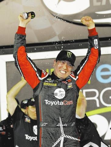 Kyle Busch celebrates after winning the NASCAR Truck Series auto race at Daytona International Speedway in Daytona Beach, Fla., Friday, Feb. 21, 2014. (AP Photo/Terry Renna)