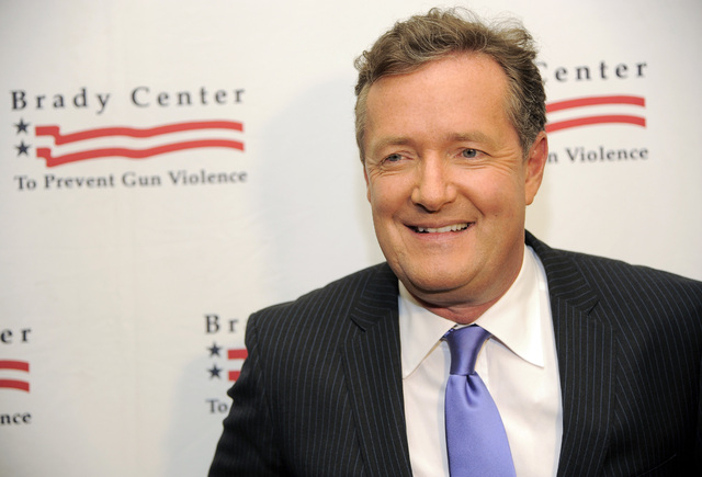 Piers Morgan is shown at the Brady Campaign to Prevent Gun Violence Los Angeles Gala at The Beverly Hills Hotel in Beverly Hills, Calif., in this May 7, 2013, file photo. CNN said Sunday, Feb. 23, ...