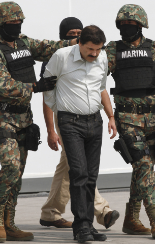 "Joaquin ""El Chapo"" Guzman is escorted to a helicopter in handcuffs by Mexican navy marines at a navy hanger in Mexico City on Saturday. A senior U.S. law enforcement official said Saturday, that G ..."