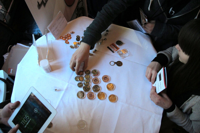 Attendees of the Inside Bitcoins conference in Berlin examine Bitcoin buttons. The website of major Bitcoin exchange Mt. Gox is offline amid reports it suffered a debilitating theft of the virtual ...