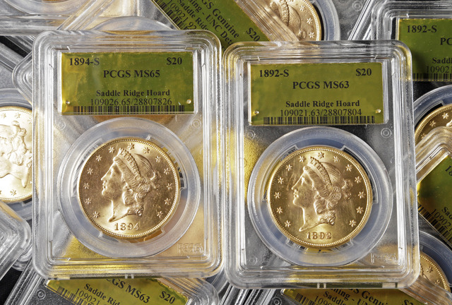 Some of 1,427 Gold-Rush era U.S. gold coins are displayed at Professional Coin Grading Service in Santa Ana, Calif., Tuesday, Feb. 25, 2014.  A California couple out walking their dog on their pro ...