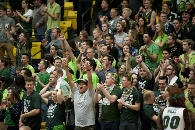 In this Thursday, Feb. 27, 2014 photo, Utah Valley State fans celebrate during the second half of an NCAA college basketball against New Mexico StateNew Mexico State's Daniel Mullings, center left ...