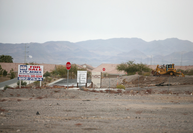 A crew works on a parcel of land north of RC Willey Home Furnishings located on Stephanie Street near the 215 Beltway Thursday, Feb. 6, 2014, in Henderson. The Canyon-Agassi Charter School Facilit ...