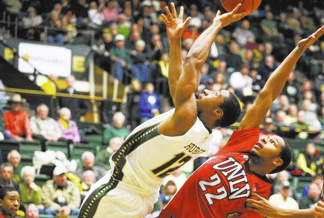 Colorado State guard Carlton Hurst (12) is fouled by UNLV guard Jelan Kendrick as he puts up a shot during the teams' Mountain West game in Fort Collins, Colo., on Wednesday. (AP Photo/The Color ...