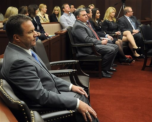 Eddie Lorton, a candidate for Reno mayor, front left, sits in the Nevada Supreme Court Tuesday Jan. 21, 2014 along with Dwight Dortch, in gray suit and red tie, and Jessica Sferrazza, second right ...