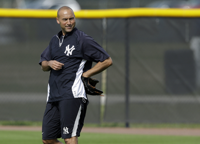 New York Yankees shortstop Derek Jeter smiles during practice at the Yankees' minor league facility on Wednesday in Tampa, Fla. Jeter posted a long letter on his Facebook account Wednesday, saying ...