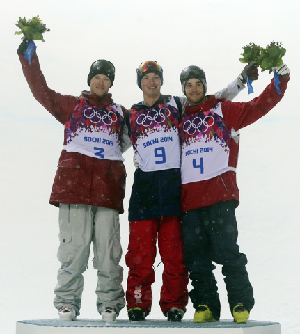 Gold medalist David Wise of the United States, center, celebrates with silver medalist Mike Riddle of Canada, left, and bronze medalist Kevin Rolland of France after the men's ski halfpipe final a ...