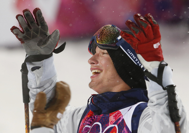 David Wise of the United States celebrates after learning he won the gold medal in the men's ski halfpipe final at the 2014 Winter Olympics, Tuesday.  (AP Photo/Sergei Grits)
