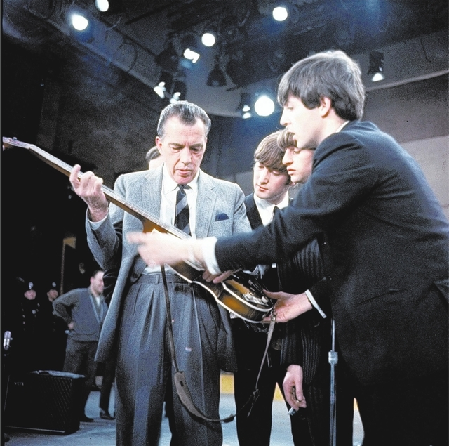 The Beatles are shown with Ed Sullivan on stage Feb. 10, 1964 before their TV performance on his show in New York. (AP Photo)