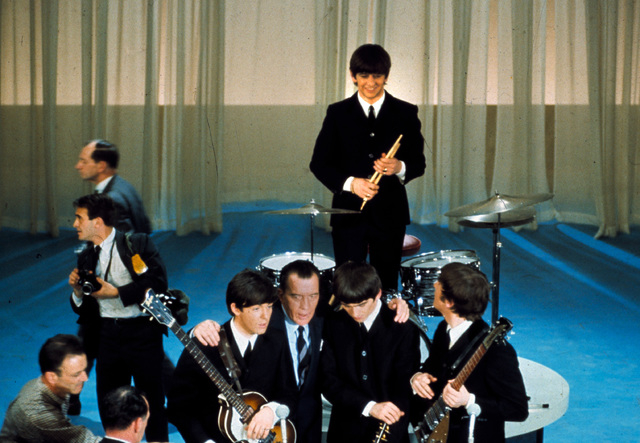 The British rock and roll group the Beatles are shown on stage with Ed Sullivan before their live television appearance on the The Ed Sullivan Show at CBS' Studio 50 in New York City, Feb. 10, 196 ...