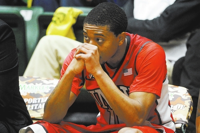 UNLV's Daquan Cook sits on the bench as he watches his team during a 75-57 loss to Colorado State in an NCAA college basketball game Wednesday, Feb. 5, 2014, at Moby Arena in Fort Collins, Colo. ( ...