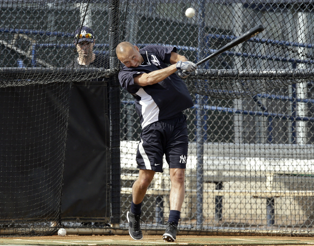 New York Yankees shortstop Derek Jeter hits the baseball during practice at the Yankees' minor league facility  Wednesday in Tampa, Fla. Jeter says he will retire after this season. (AP Photo/Chri ...