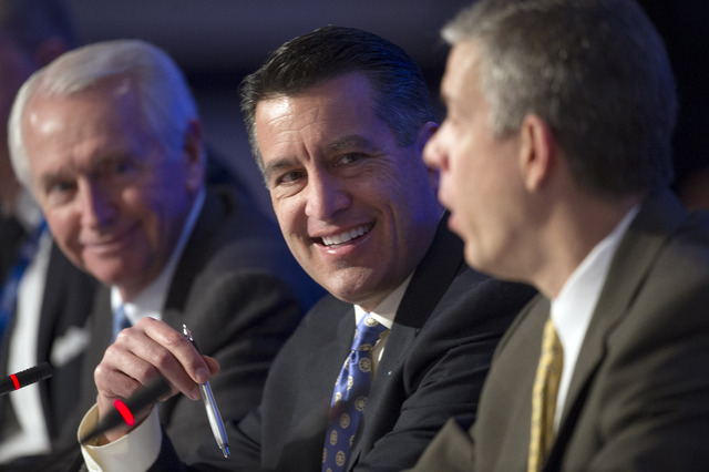 Kentucky Gov. Steve Beshear, left, looks on as Nevada Gov. Brian Sandoval, center, questions Education Secretary Arne Duncan, right, during the Education and Workforce Committee session of the Nat ...