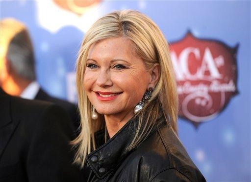 Olivia Newton-John arrives at the American Country Awards at Mandalay Bay Resort on Dec. 10, 2013. (Photo by Chris Pizzello/Invision/AP)
