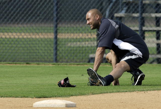 New York Yankees shortstop Derek Jeter stretches during practice at the Yankees' minor league facility Wednesday in Tampa, Fla. Jeter posted a long letter on his Facebook account Wednesday, saying ...