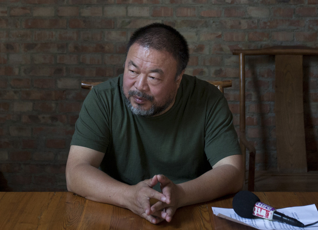Dissident Chinese artist Ai Weiwei speaks to journalists at his studio in Beijing, China, on May 22. A South Florida artist is facing a criminal charge after police say he smashed a $1 million vas ...